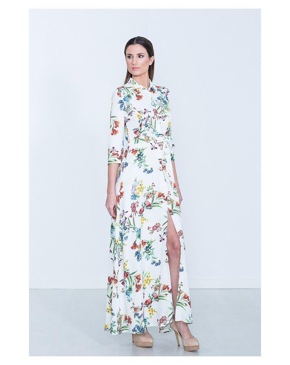 17a33e839 Vestido largo con estampado de flores y abierto en la parte de la falda y  con botones con fondo en color blanco