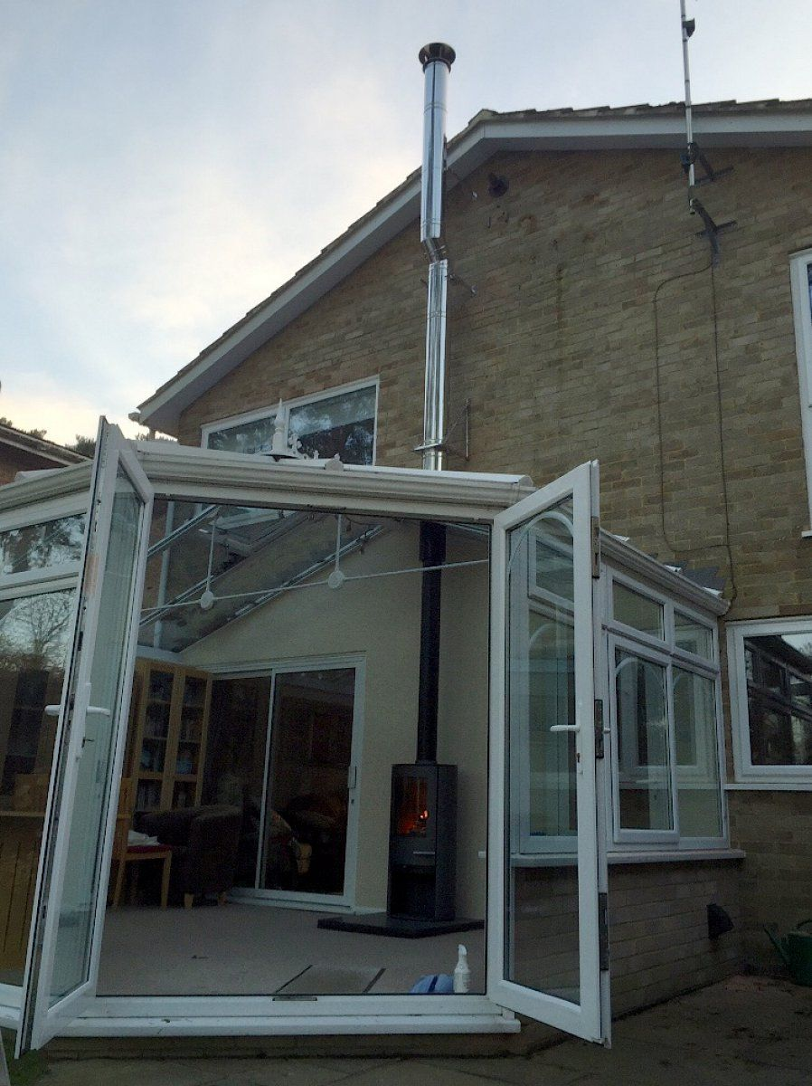 Image Showing An External Flue Into A Conservatory Indoor Outdoor Fireplaces Stove Installation Chimney Design