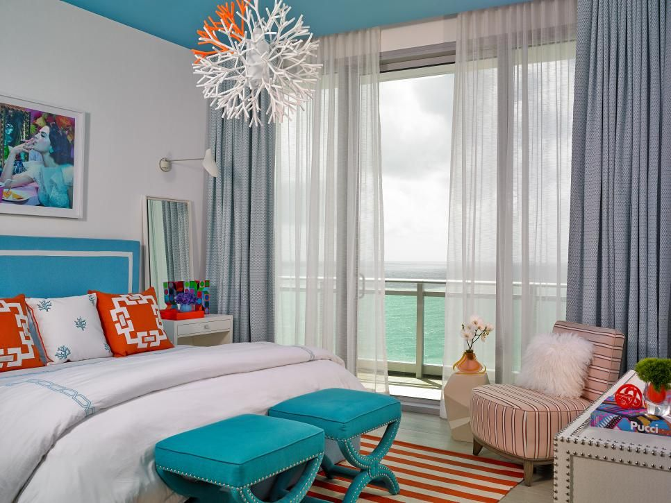 beautiful tropical nuance bedroom | Blue and White Tropical Bedroom With Orange Pillows in ...