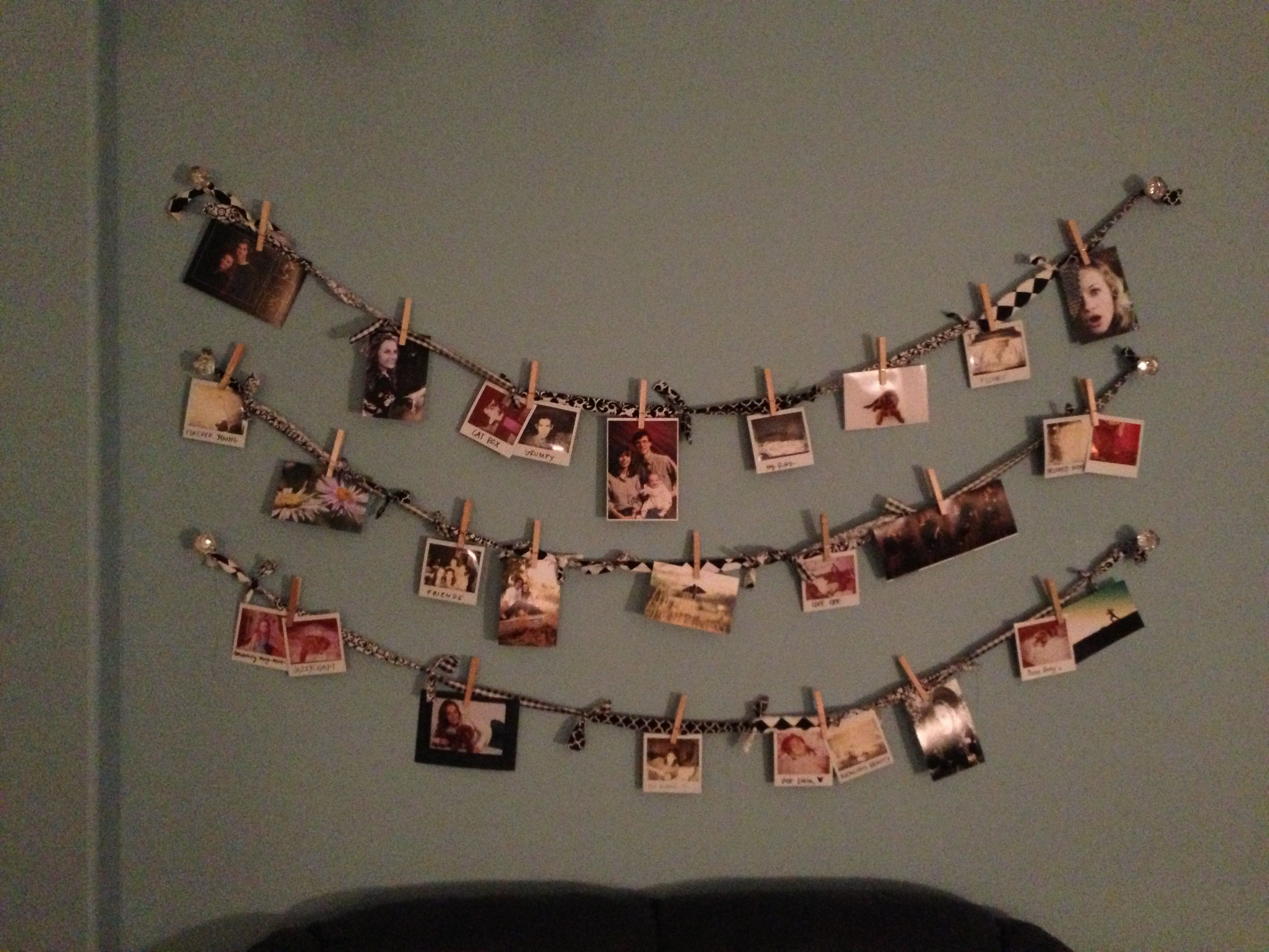 A Cute And Simple Way To Hang Photos Without Frames Or Tape 1 Decorative Doors Connected By Tied Ripped Fabric 2 Clothes Pins