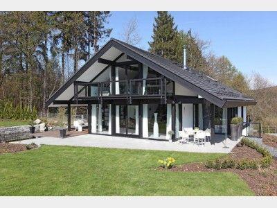 modernes fachwerkhaus mit satteldach und versteckter garage von davinci haus gmbh co kg. Black Bedroom Furniture Sets. Home Design Ideas