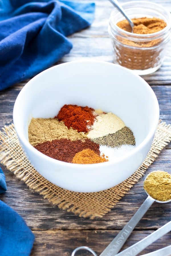Homemade Taco Seasoning #tacoseasoningpacket Multiple Mexican spices in a white bowl to make a gluten-free, Paleo, and Whole30 taco seasoning recipe. #diytacoseasoning