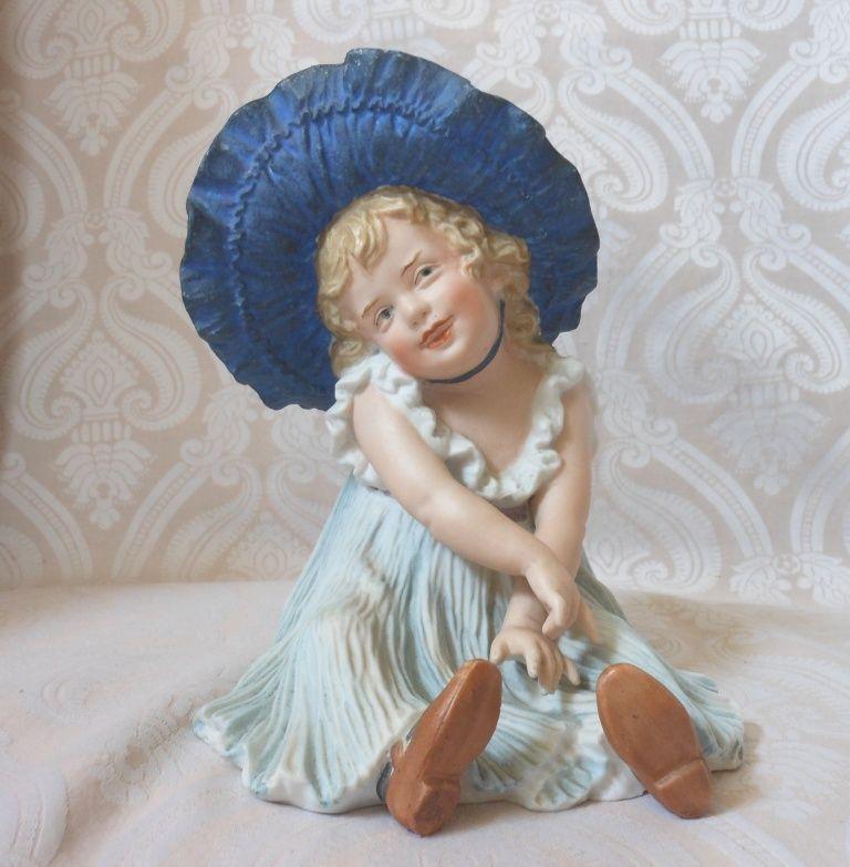 Gebruder Heubach German Bisque Bonnet Girl Piano Baby Figurine in a from joan-lynetteantiquedolls on Ruby Lane