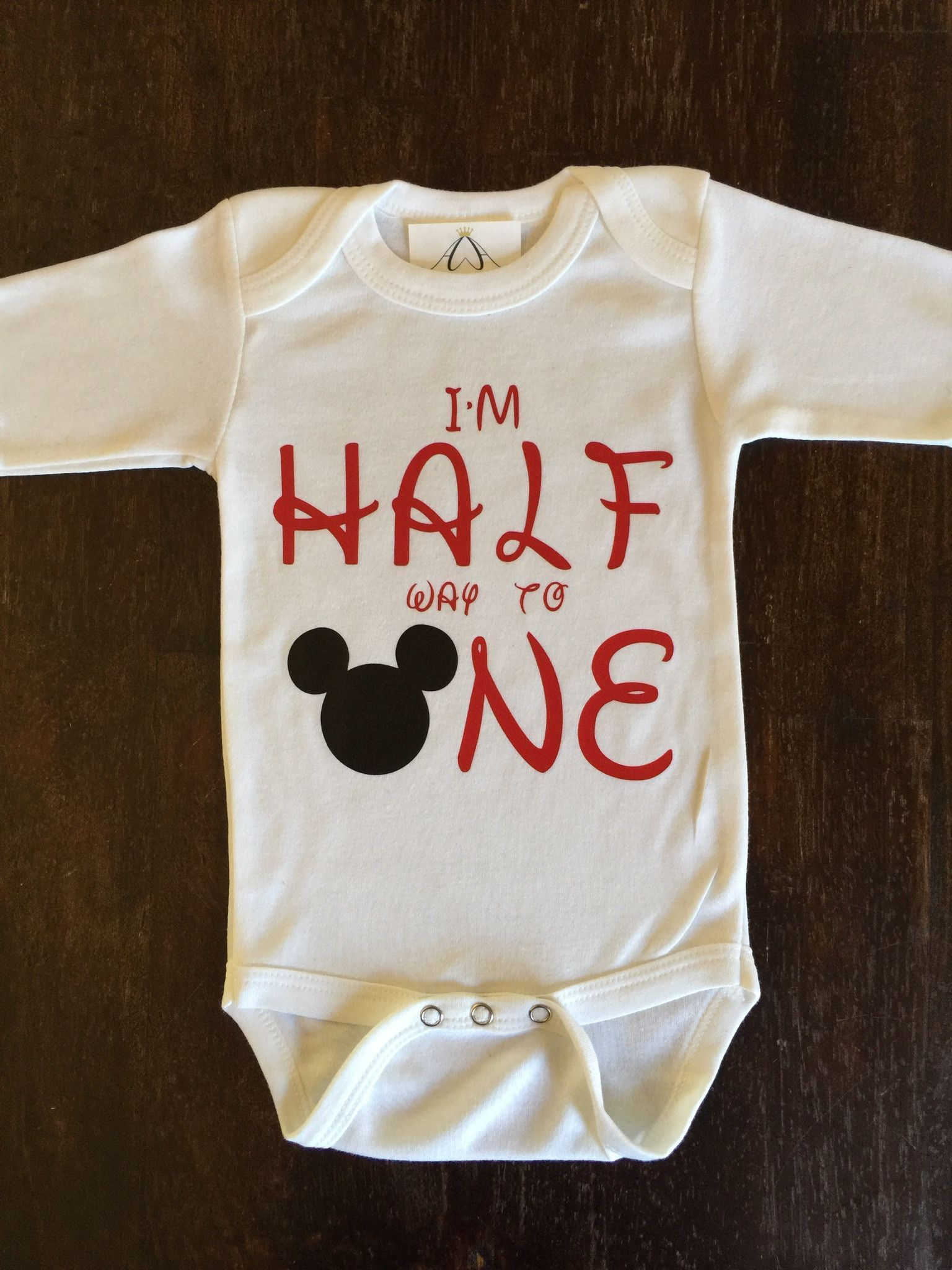 df239b576 MICKEY I'm half way to one long sleeve onesie! -Super soft and comfy, with long  sleeves. -100% Baby Rib cotton construction -Neckband designed for easy ...