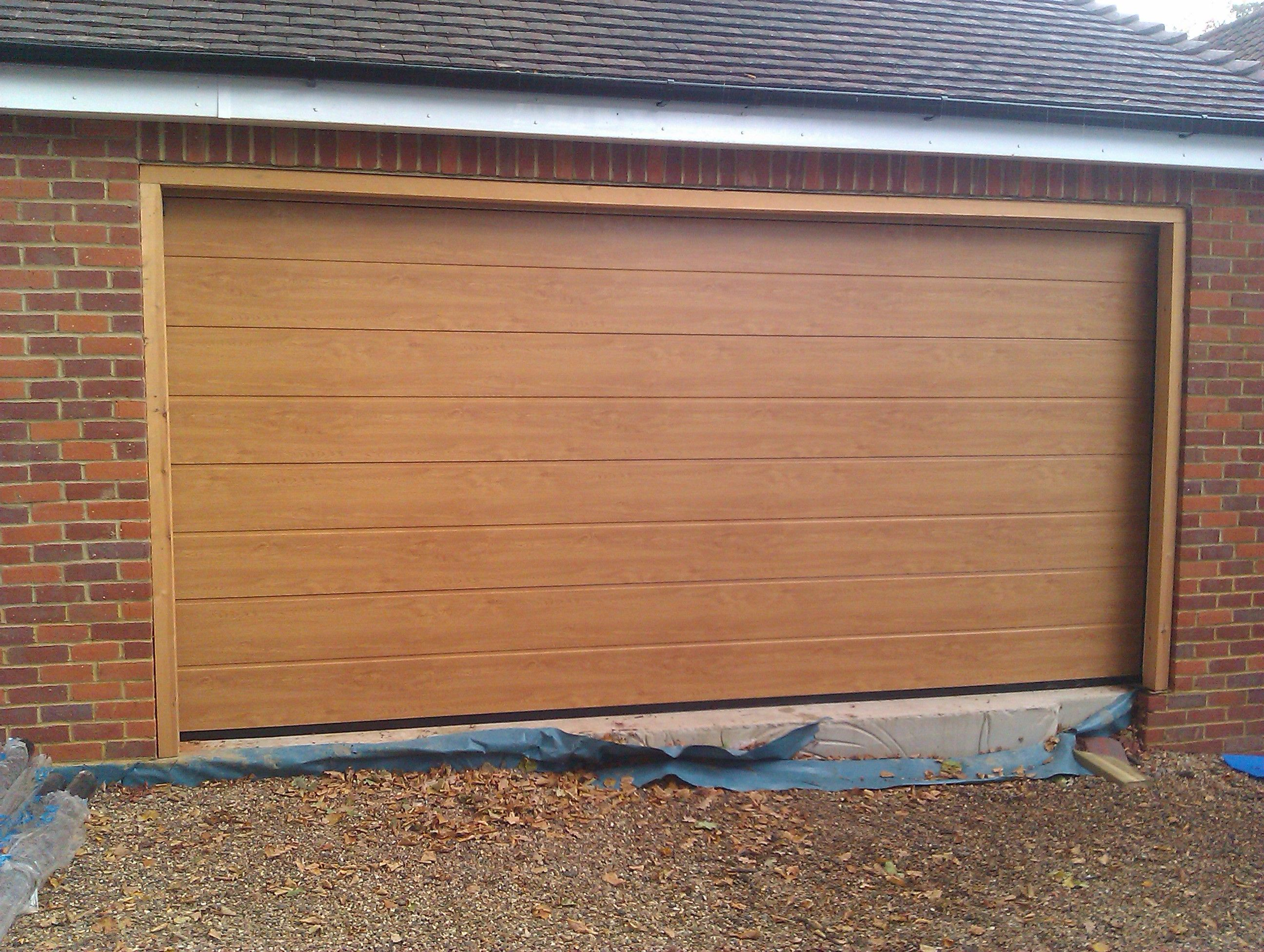 Hormann sectional garage door wood google search for Sectional glass garage door