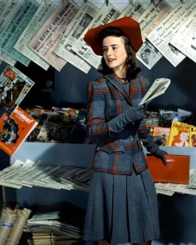 September 1941 Dorothy Shapard, student at Vassar, in a career classic blue grey wool dress with a plaid jacket in blue, grey, red and black and a red hat. Via dovima_is_devine_II on Flickr.