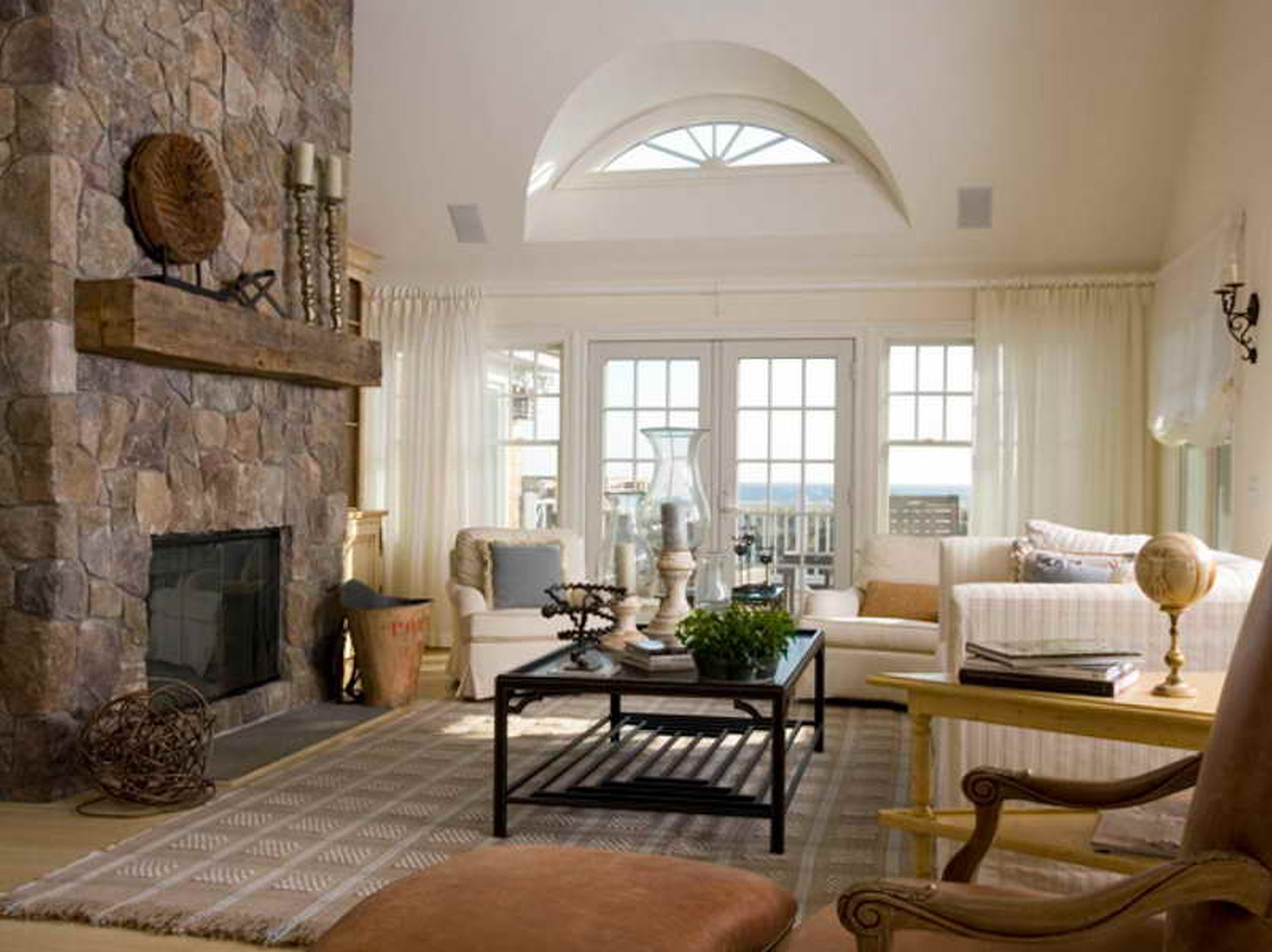 Furniture Awesome Living Room With Fieldstone Fireplace White Sofa And Iron Table Brick