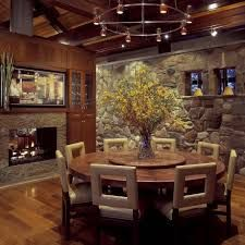 Great Integration Of The Stone And Lighting Round Dining Room