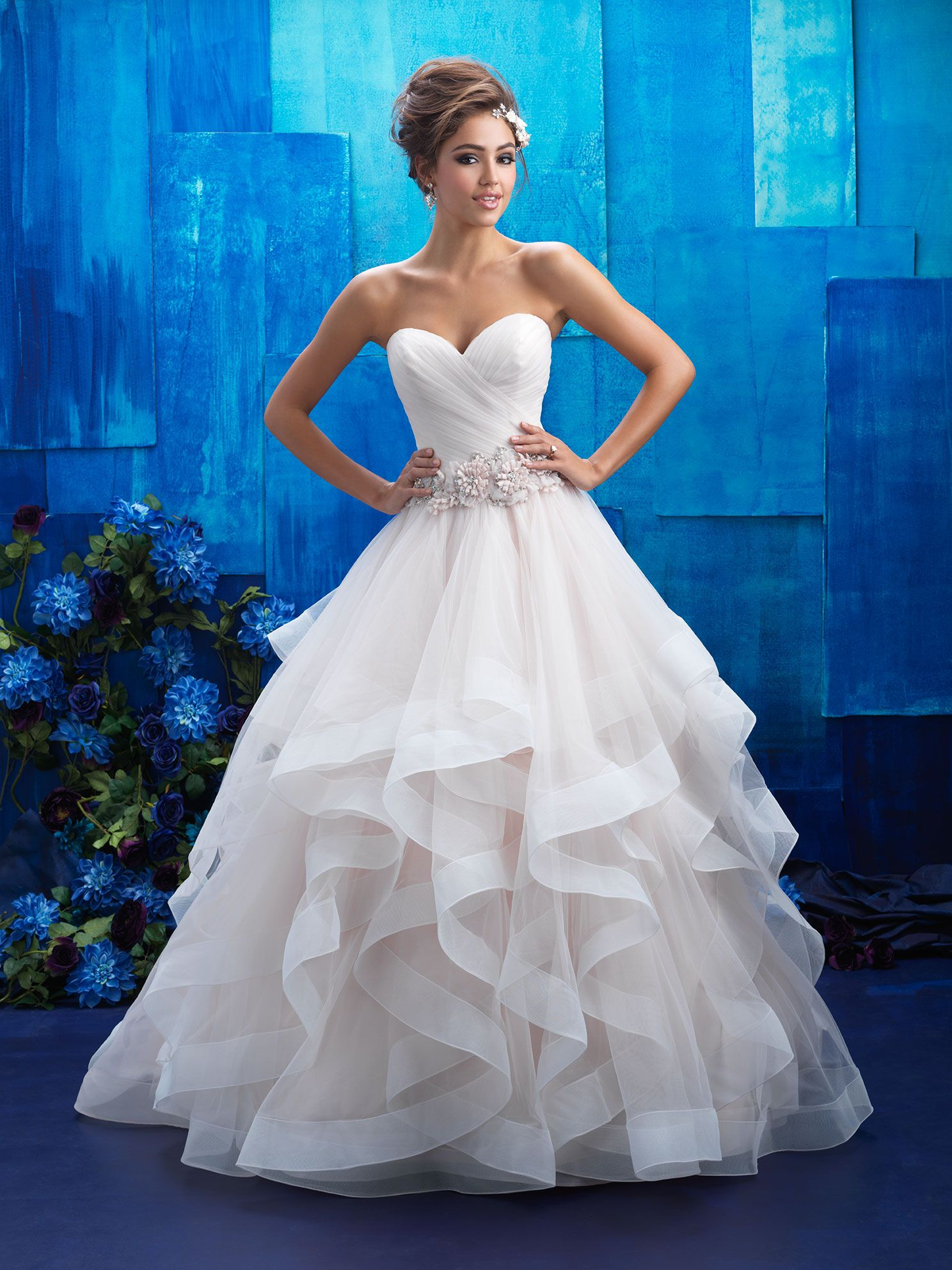 The sheer ruffles adorning this gown s ballgown skirt are both fluid and  structured dddcb35e29ed