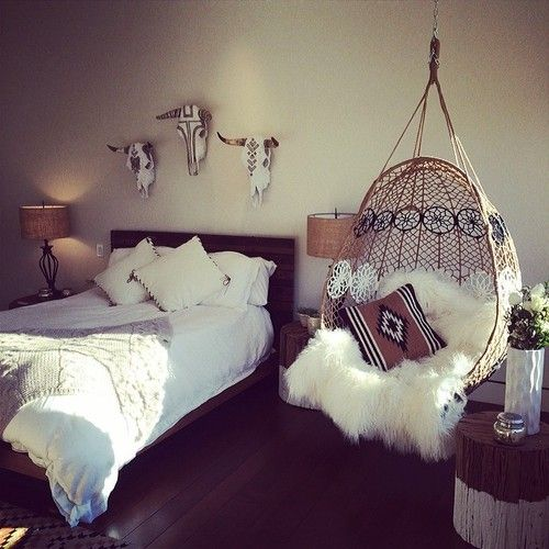 Engraved Cow Skull, Suspended Wicker Chair, Sheepskin, Lots Of White And  Lots Of Light.