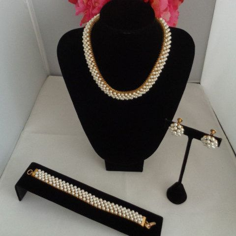 Coupon Code 050116 - Hobe Vintage Pearl Necklace, Matching Bracelets and a Pair of Screw Back Earrings Signed. This is a rare and stunning set in great condition. Have a great Mother's Day. This is on sale for one more day. Take advantage of the discount and buy yourself a classic Hobe Vintage Jewelry Set. Have a great vintage day! Best wishes to you & yours, Coco