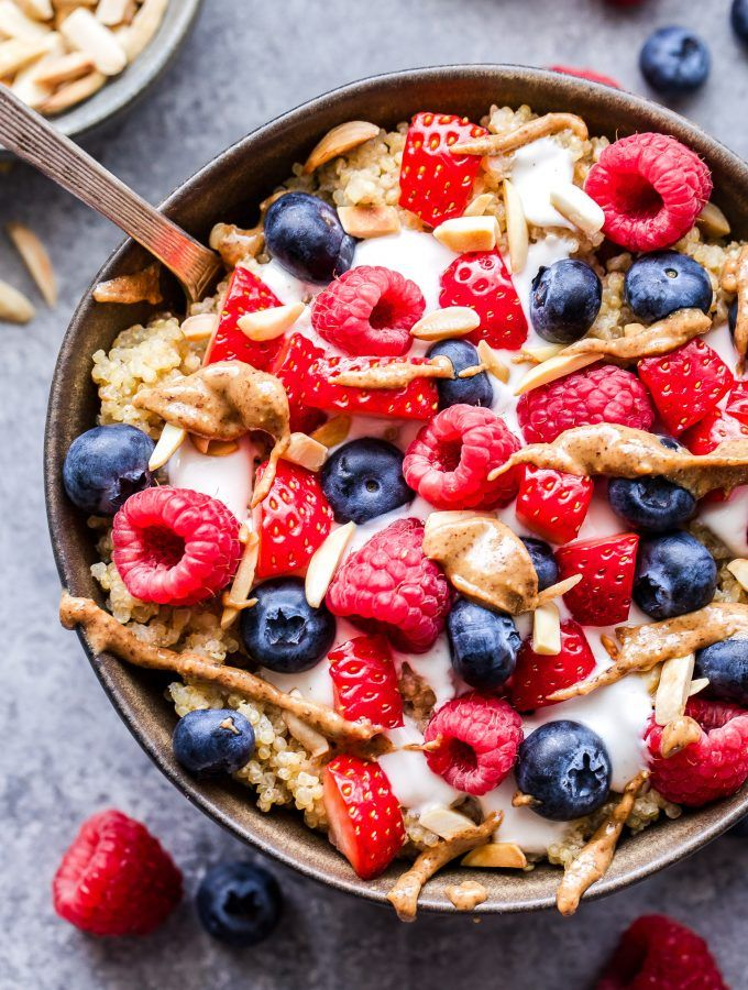 Berry Quinoa Breakfast Bowls topped with berries, Greek ...