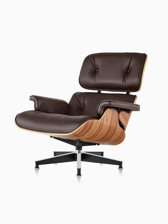 Brown Eames Lounge Chair with a wood veneer shell, viewed