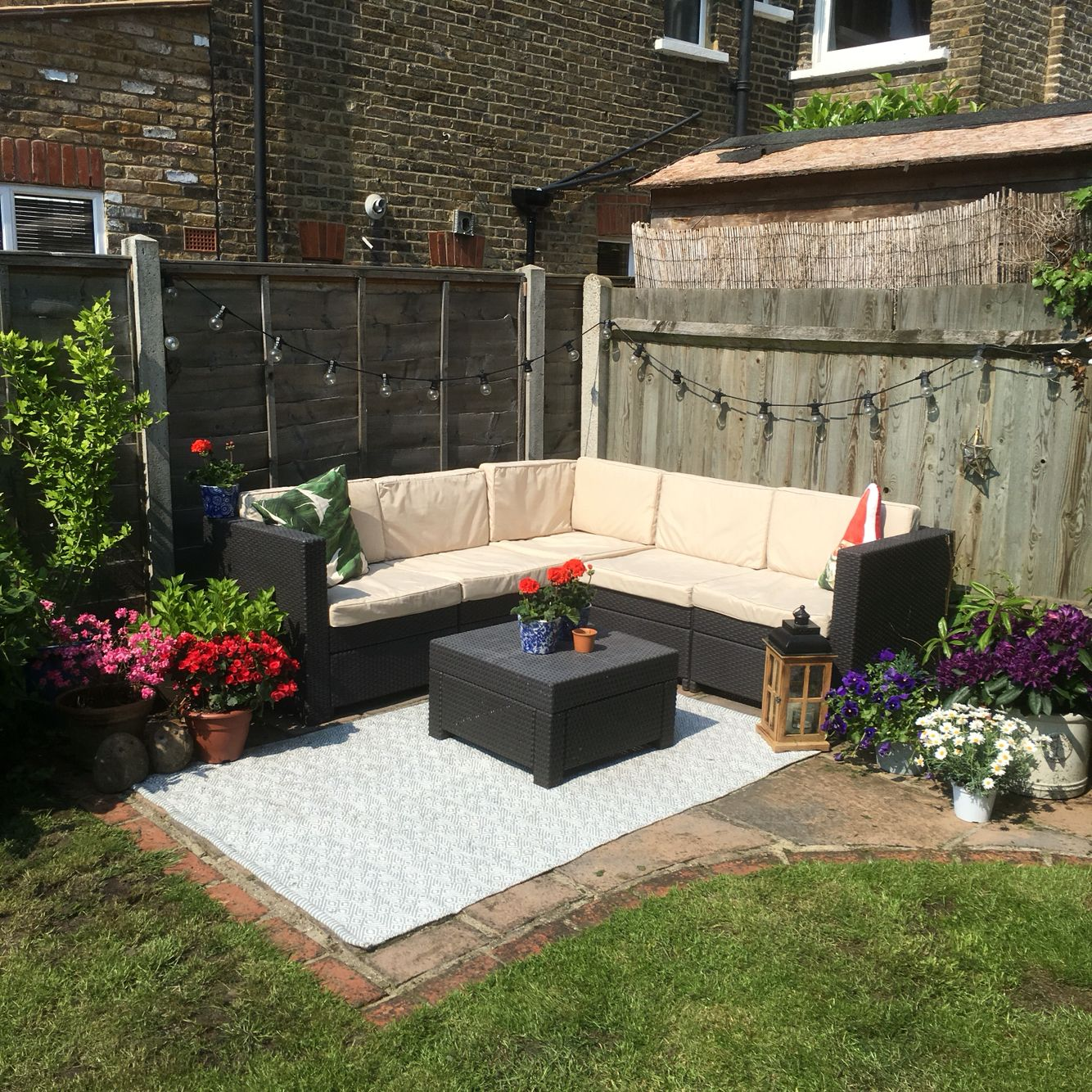 small garden corner rattan garden furniture festoons - Garden Furniture For Small Gardens