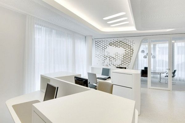 Working desks with computer stations and white cabinets modern