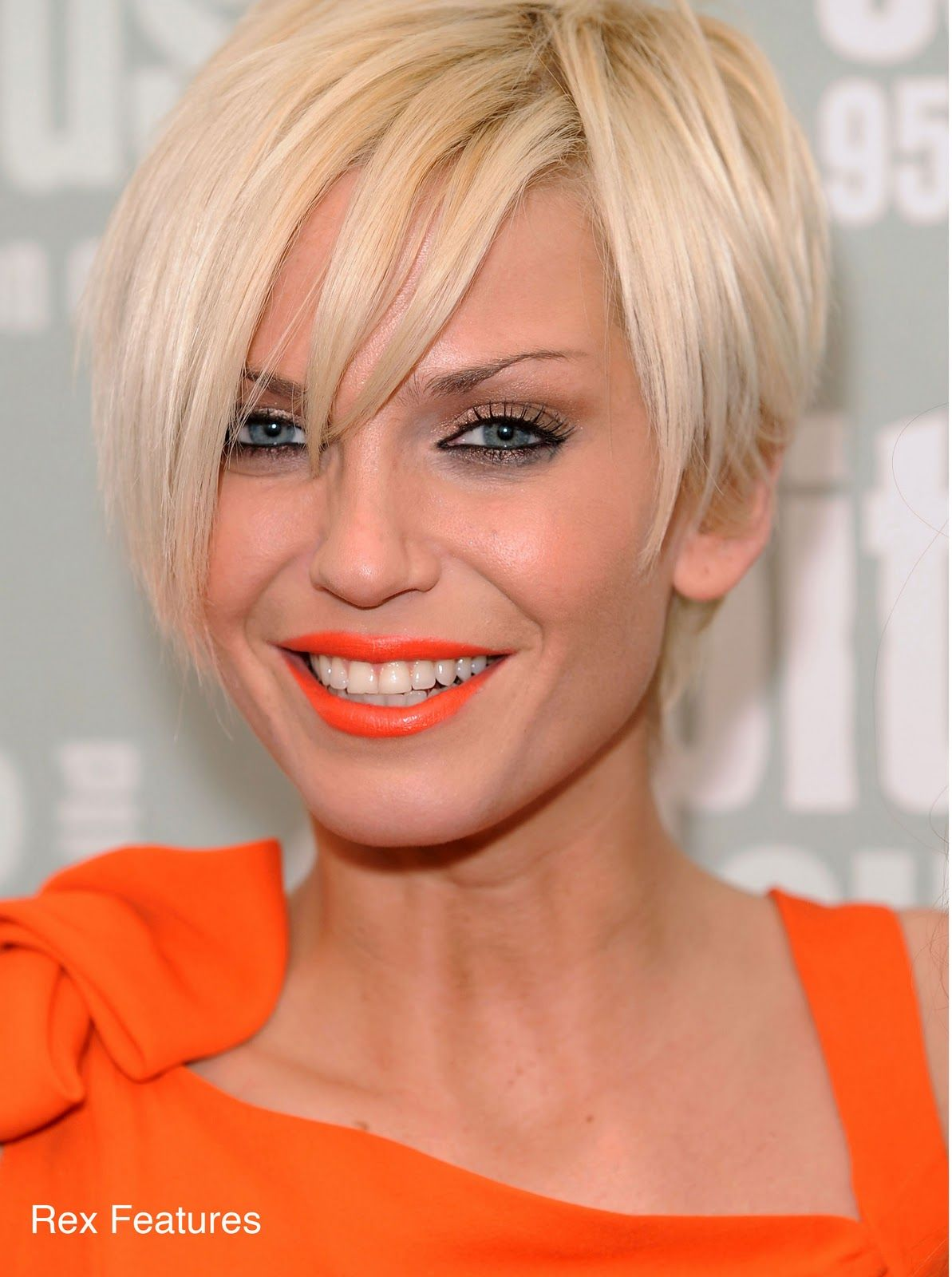 sarah harding with orange lips and a blonde bob | makeup and