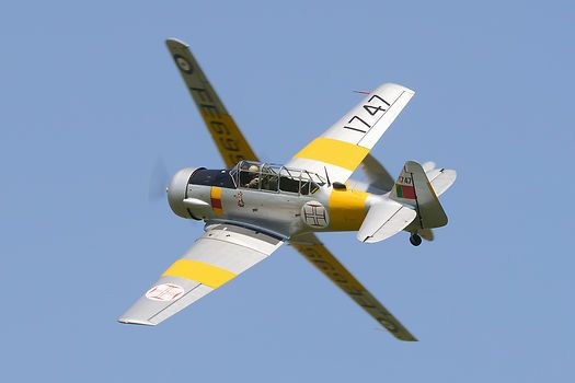 A 1953 vintage Harvard Mk4 in Portuguese Air Force colours breaks formation at Duxford Jubilee Airshow.