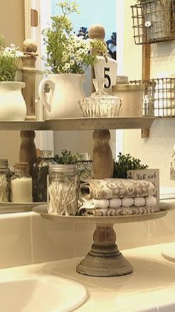 gorgeous bathroom organization. 2 tiered tray to store