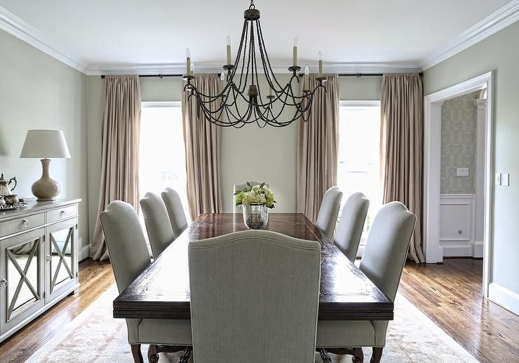 Elegant Dining Room Features A Stained Dining Table Lined
