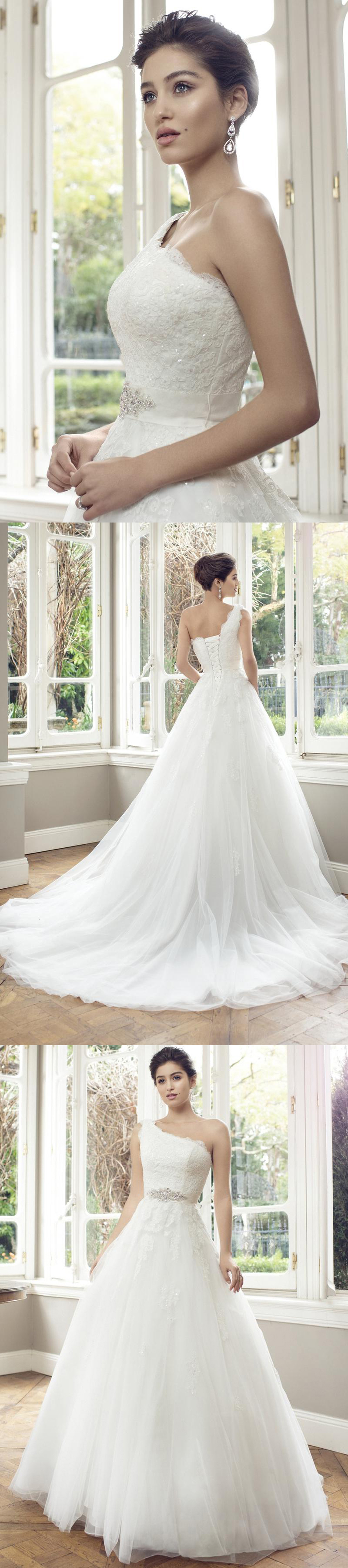 Ball gown oneshoulder sleeveless jeweled floorlength tulle wedding