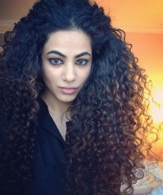 Arabian girl with curls. Thick natural curly hair
