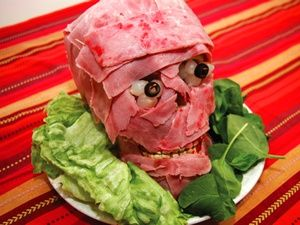 Meat heads line skull with red jello giggler 1/2 inch thick for brains then layer with meat use eggs for eyes or cauliflower and olive slices.