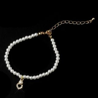 "Pretty Gold Ivory pearl bracelet with crystal accent.  Size: 6""-7"" long."