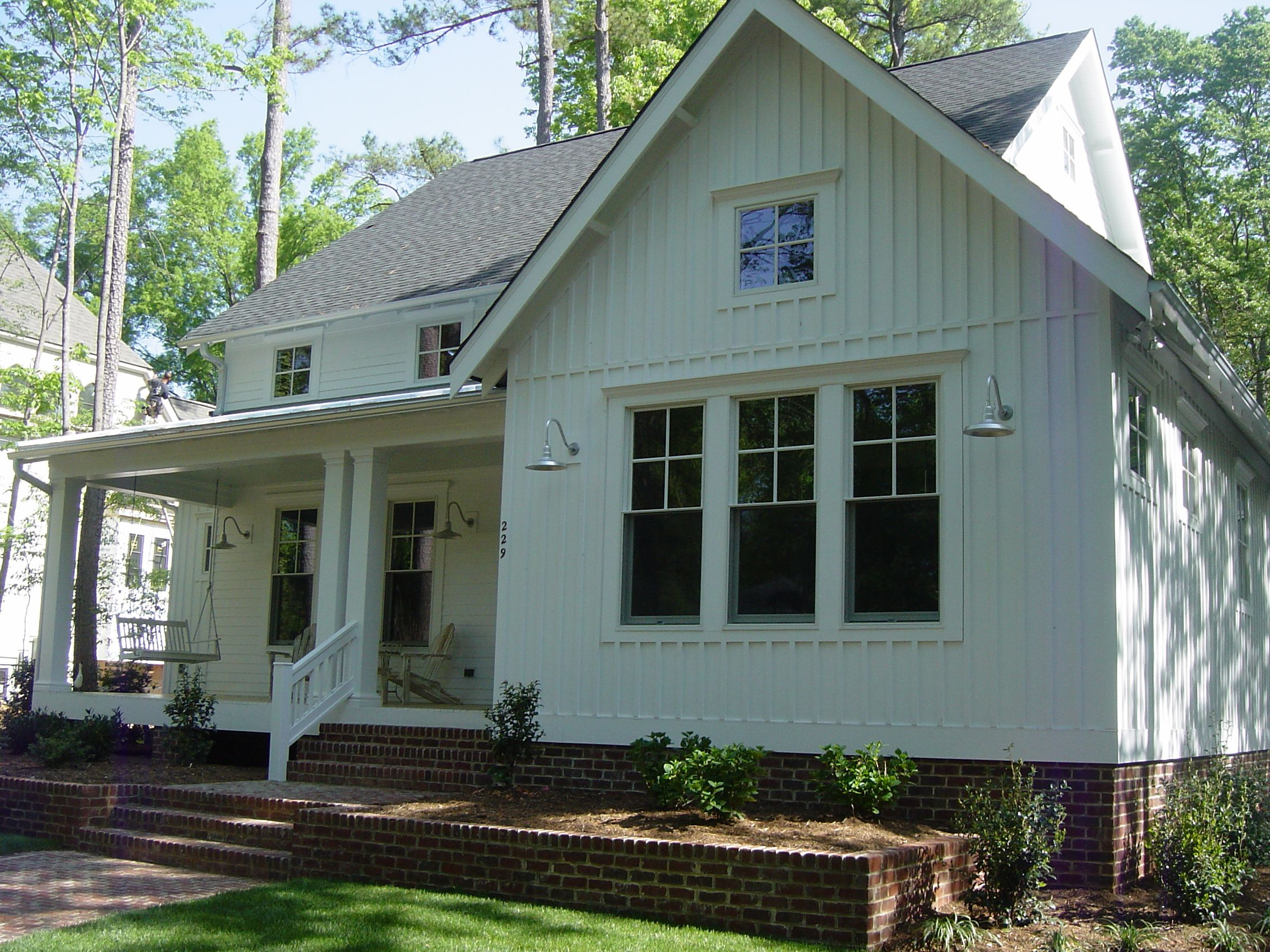 just love this new farmhouse style home with batten board ForFarmhouse Style Siding