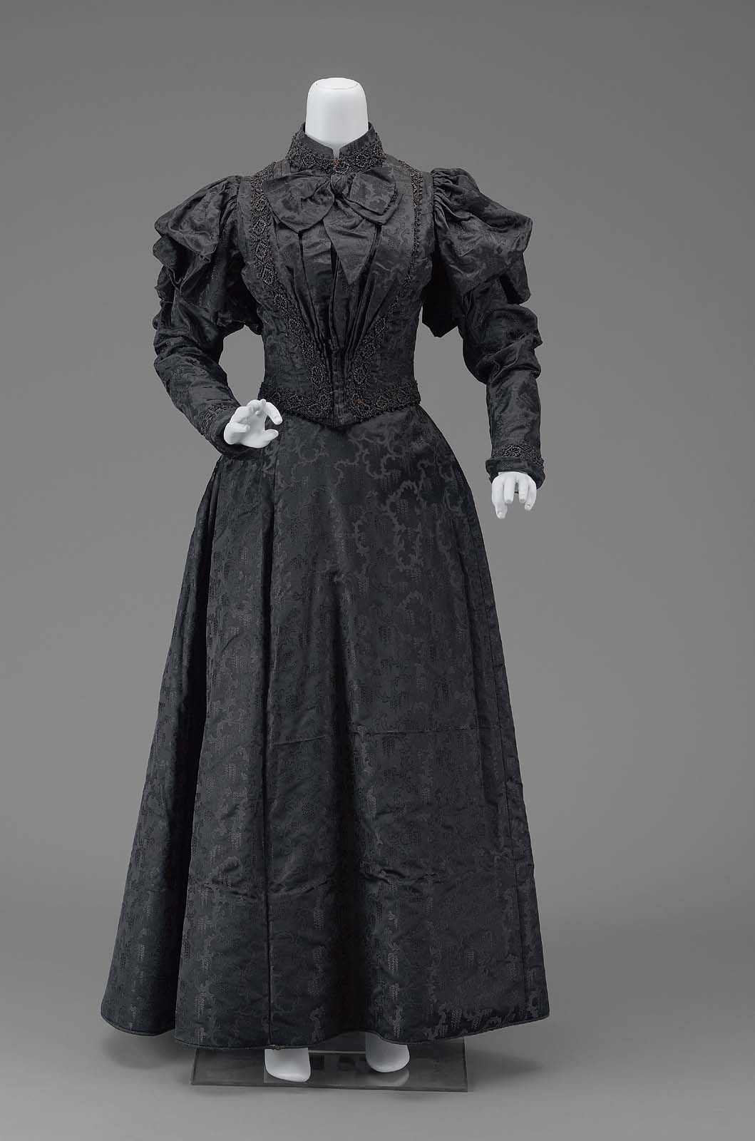1890, America - Dress - Silk satin figured weave with jet-beaded trimming, silk satin lining, boning, and metal hook and eye closures