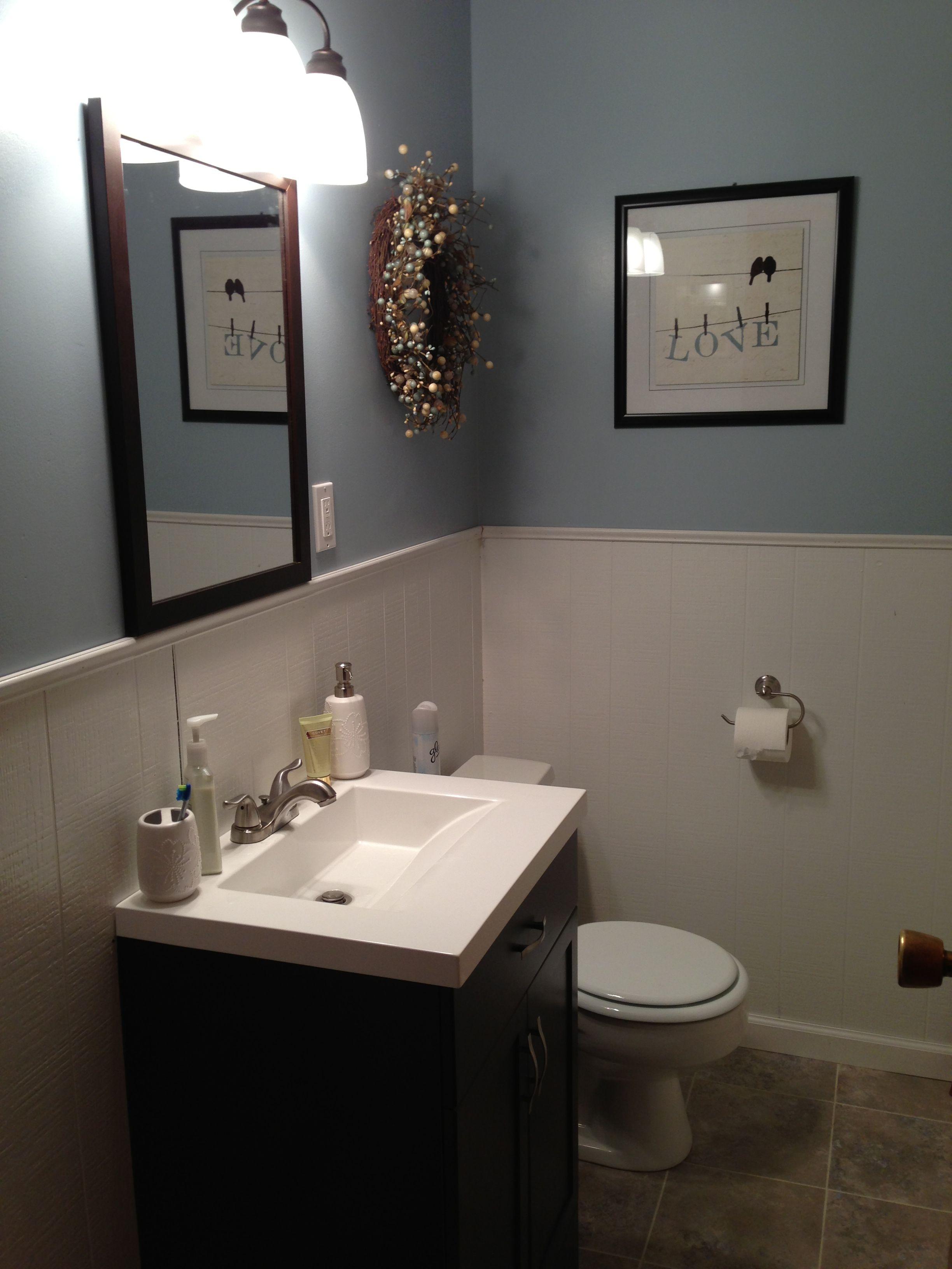 New bathroom!! Budget: $480. Includes floor, paint, trim, vanity, mirror, bathtub facet, vanity facet, and shower curtain!!