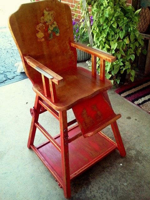 antique high chair that folds down into a desk on wheels