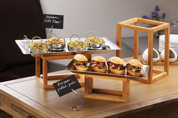 The open frame styling on these Bamboo Frame Risers lend an airy feel to  buffets. You can use them vertically or horizontally. - Bamboo Frame Riser Set Center Of Lunch Tables Zone/CCC Meeting