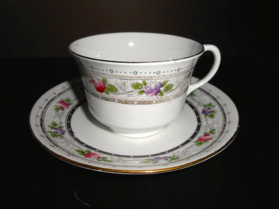 Early Shelley Rose Border Both cup and saucer are in fair condition with ware to the gold trim 10847      9.00   NORMAN Shape