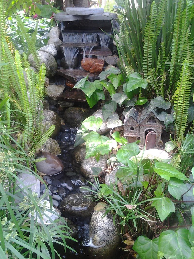 My tiny garden waterfall small stream falls into a small for Tiny garden ponds