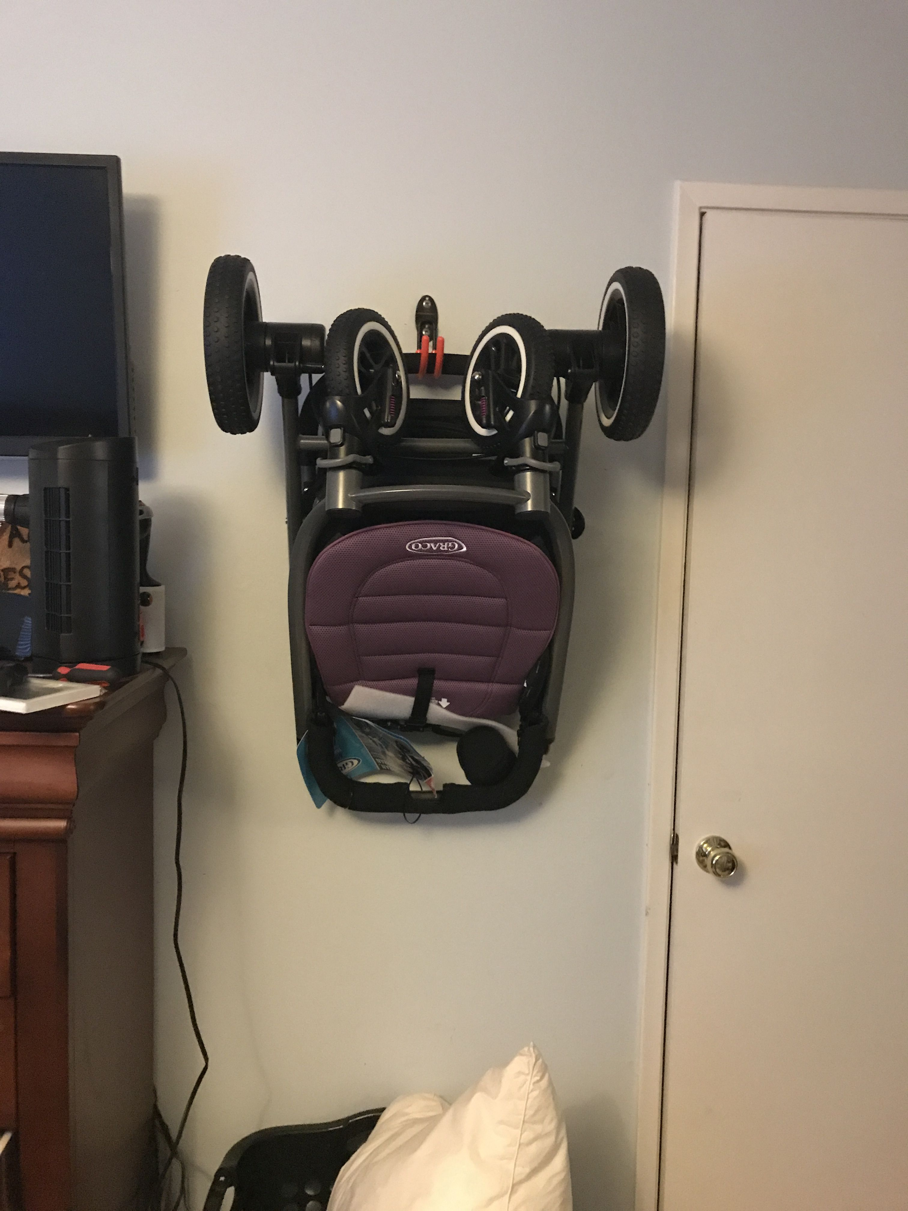 Used a hook to hang my stroller on the wall while it's not