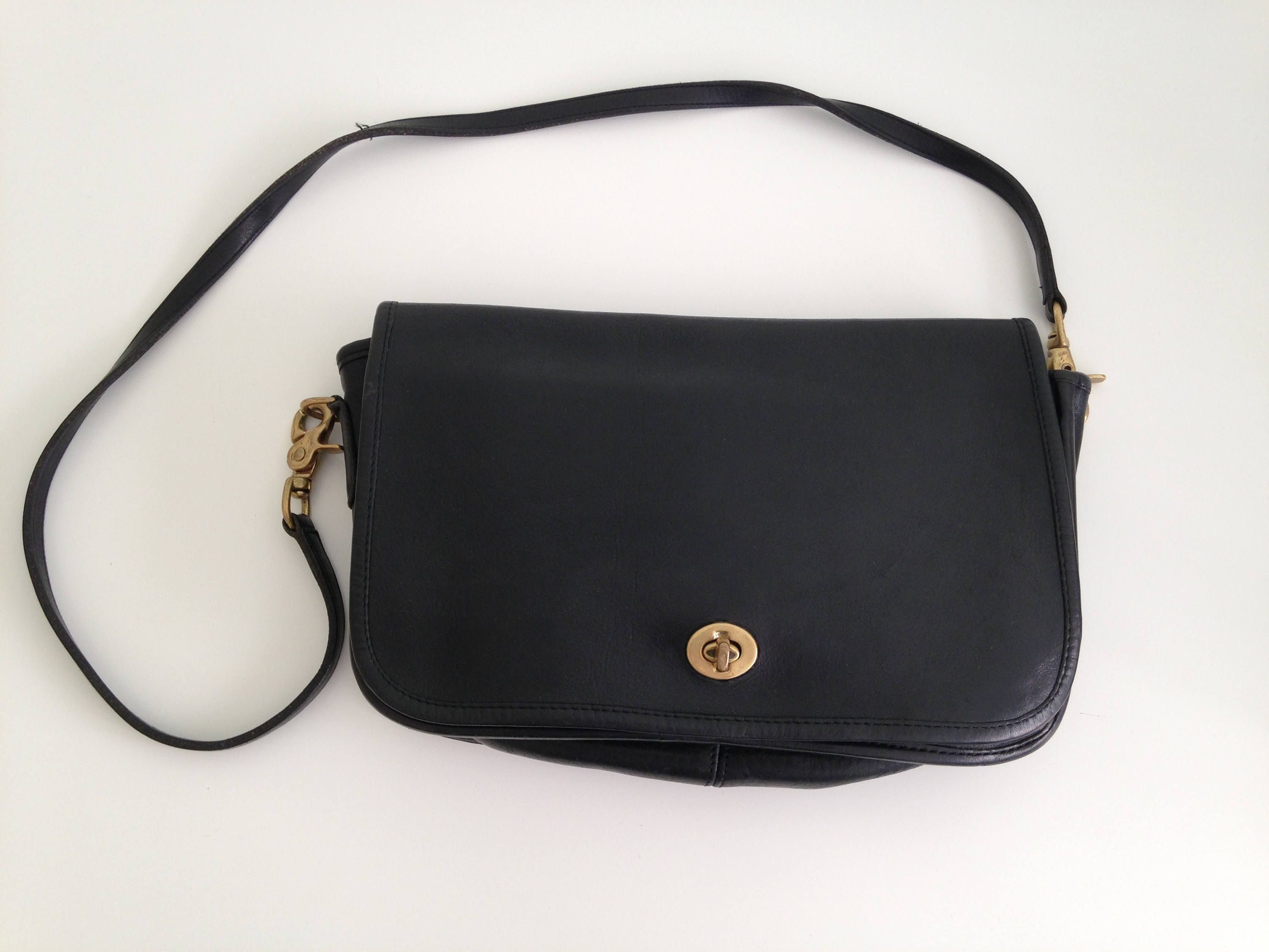 8a0b544607d37 Amazing Coach shoulder purse in black color, made of heavy genuine leather  and brass detailing