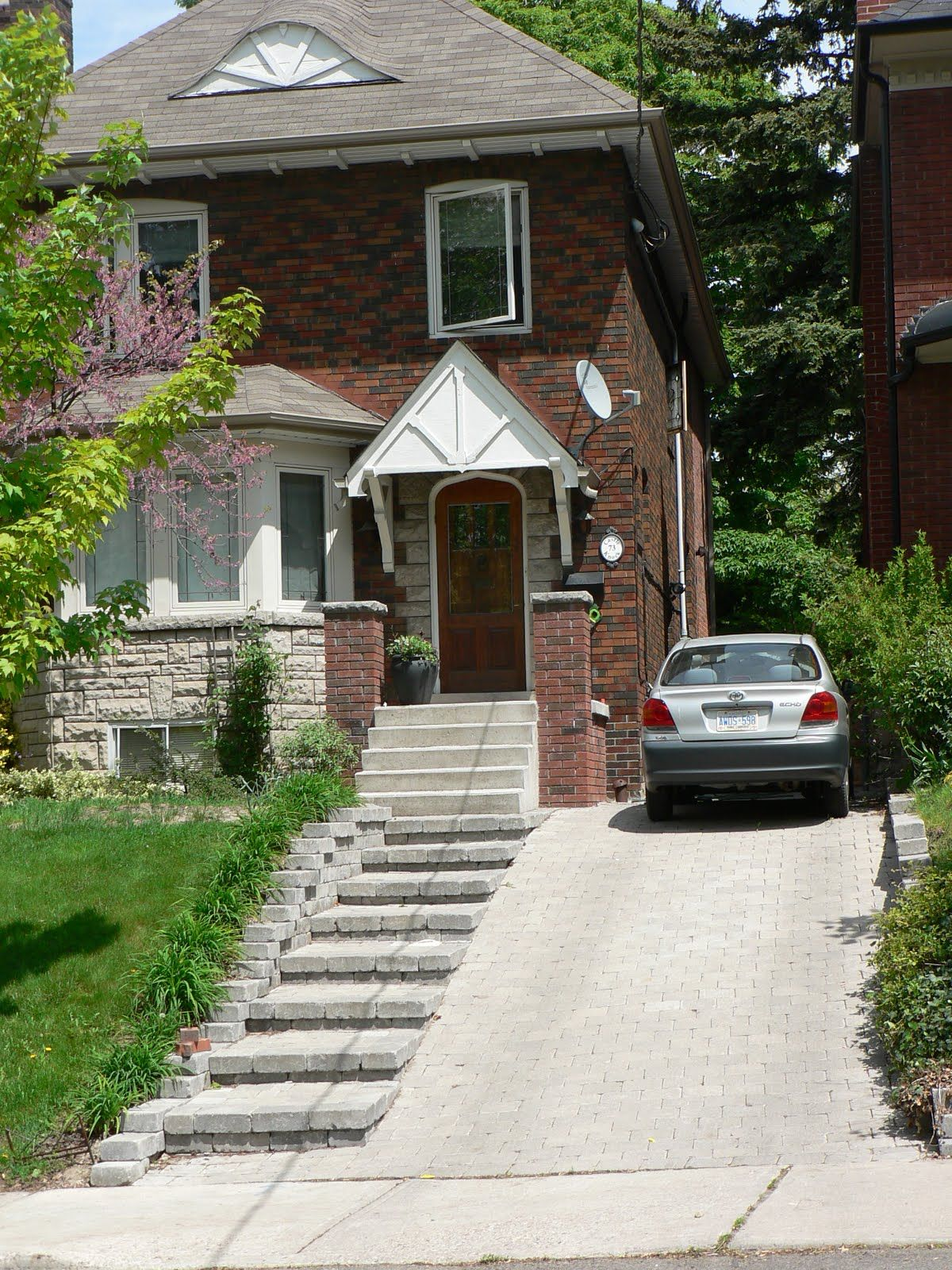 sloped driveway landscaping front