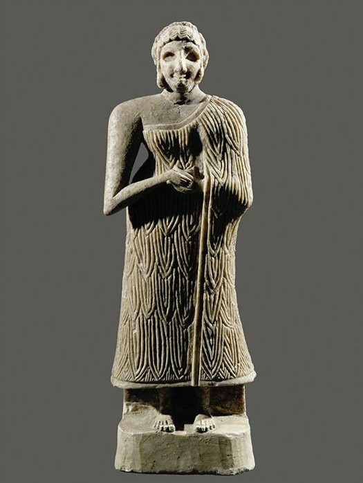"""Woman With Folded Hands"" Mesopotamian, Sumerian, Early Dynastic c. 2650-2250 BCE woman wearing what both men and women wore, the Kaunakes garment in the form of a wrapped skirt. Her hair seems to be pulled into a Chignon held in place with a Fillet, and the date could possibly assume that she is wearing her hair confined in a net also."
