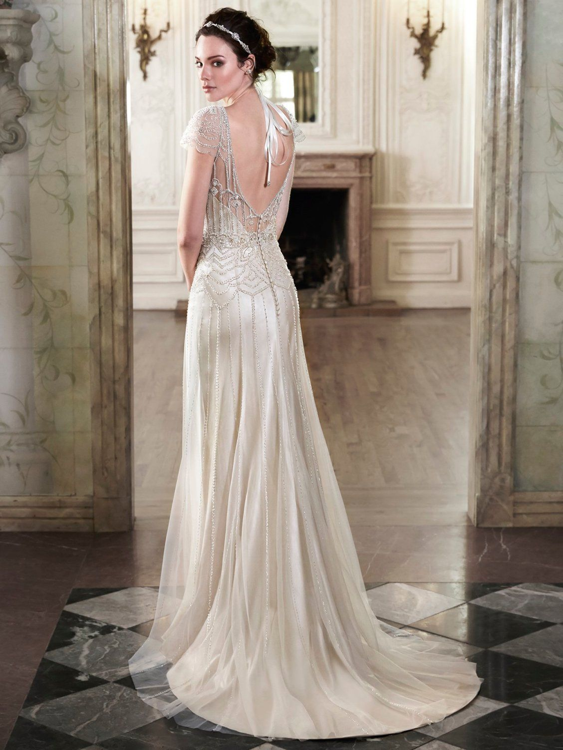 463fc894e9f Maggie Sottero Ettia wedding dress. The perfect blend of romance and  refined sophistication is found in this tulle and Vogue satin sheath wedding  dress