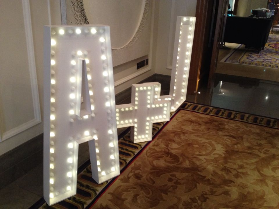 Lightbulb letters with the wedding couples initials