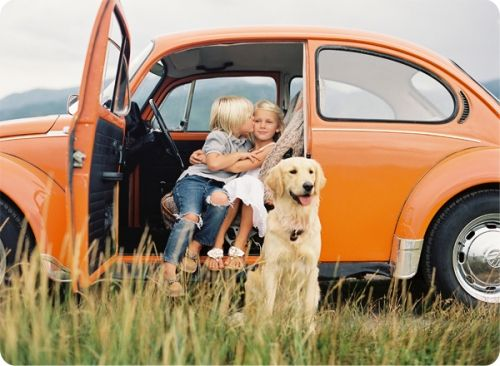 Sweet!!! This was JUST like the one we had when my sisters & I were about the age of the kiddos in the pic! ;) Orange in color & all. Mom loved 'Stanley'.  [side note: she now has a golden retriever!]