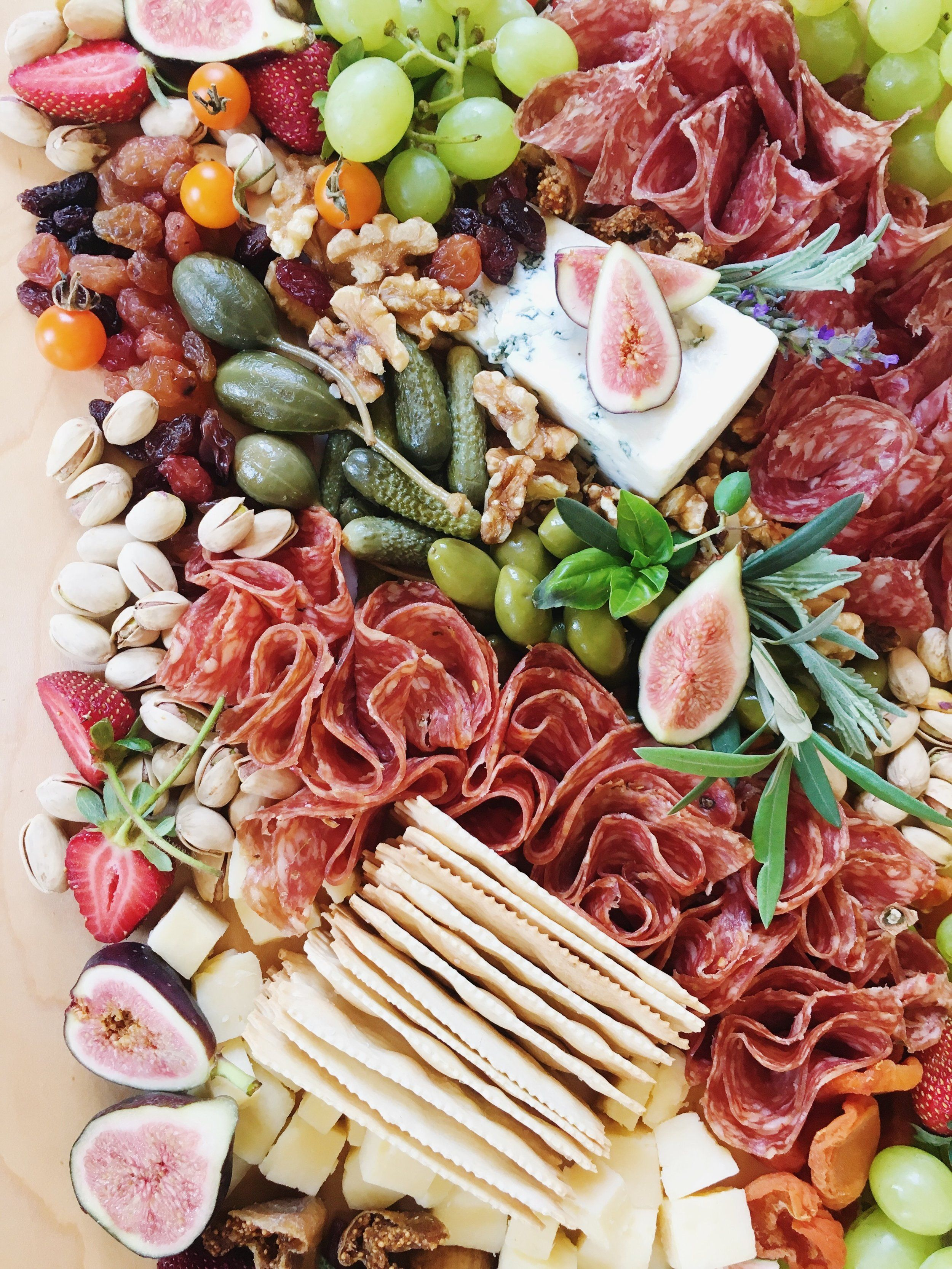Gorgeous Colorful Charcuterie Board With Meats Figs Grapes Cheese Crackers And Berries Appetizer Recipes Charcuterie And Cheese Board Food Platters