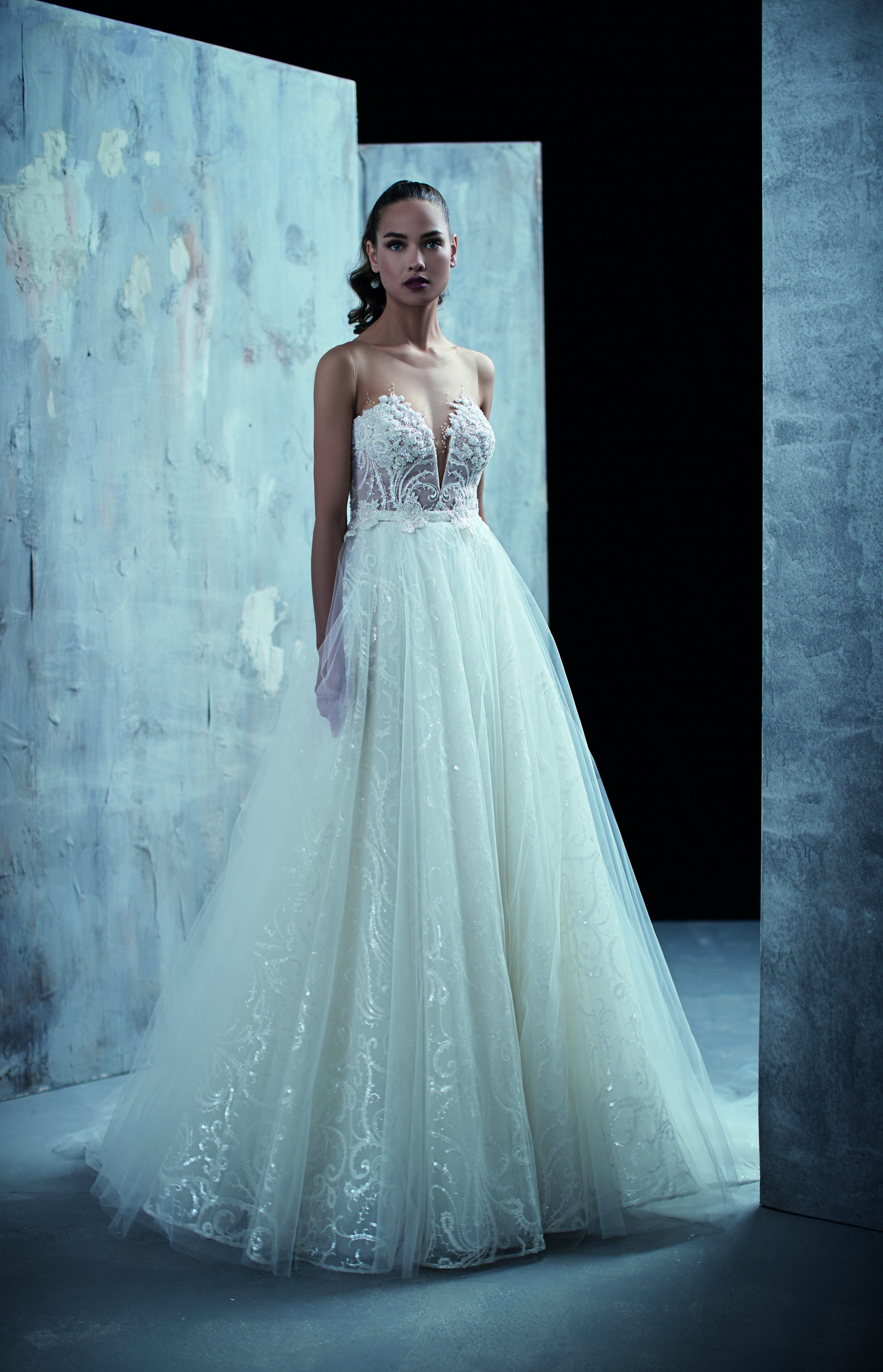 Ball gown with tulle bottom, detailed belt at waistline, and beading ...