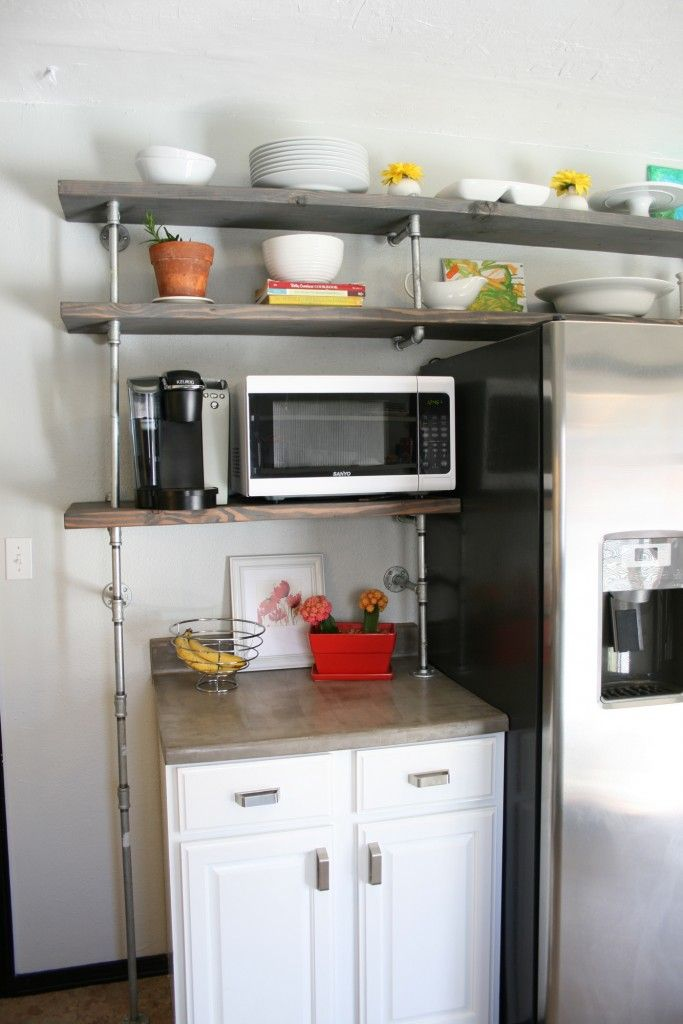 Open kitchen shelving. Wood with galvanized steel pipe ...