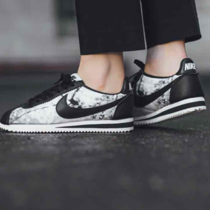 28d597d58e1 NIKE Classic Cortez limited edition. This one sports premium white and  black leather uppers –