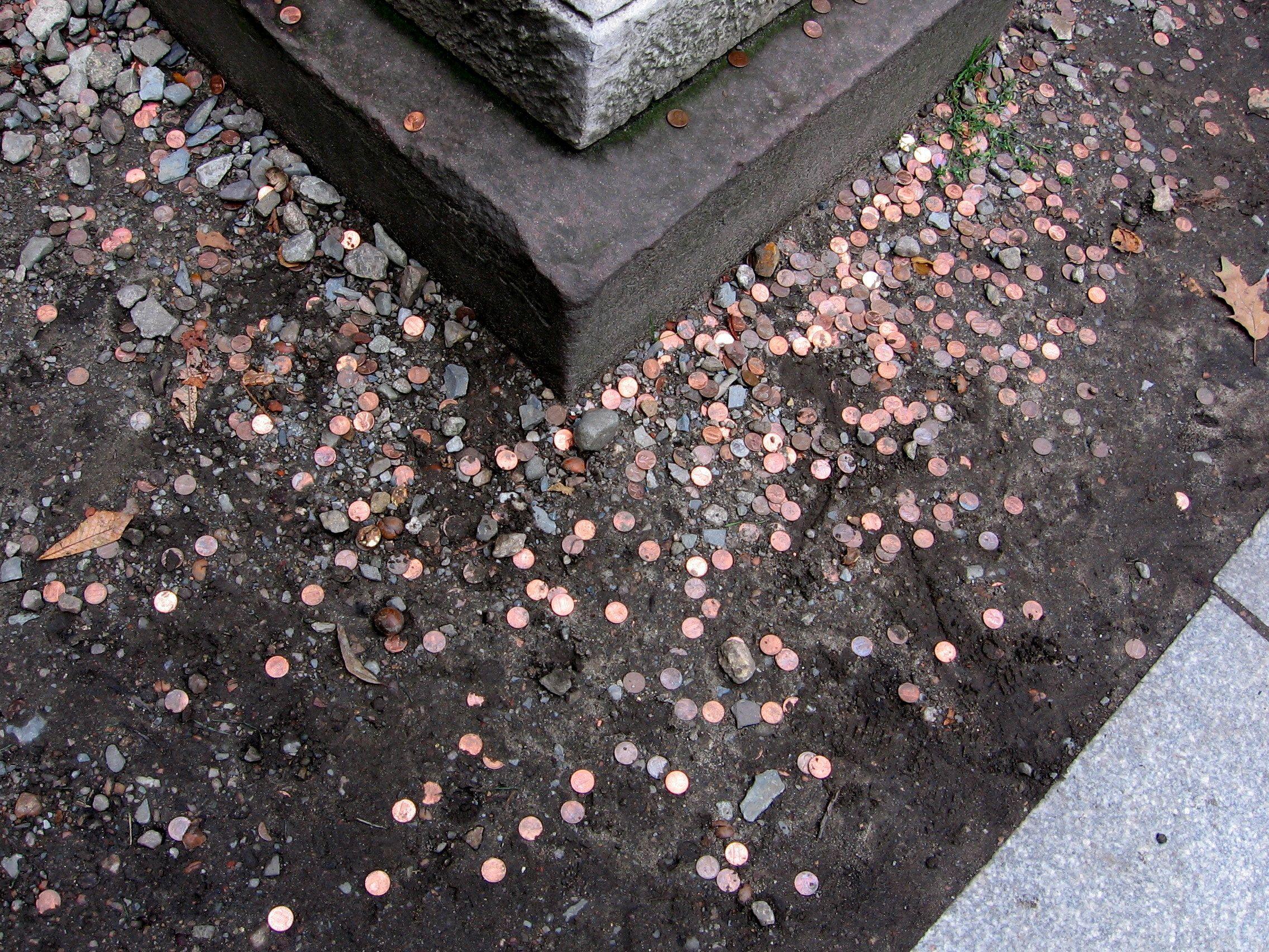 2010-10-10 Boston, Mass   Pennies on the graves.