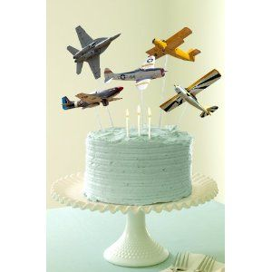 how do you get them to fly above the cake like that?  Great idea because then he gets to keep and play with them after the birthday.
