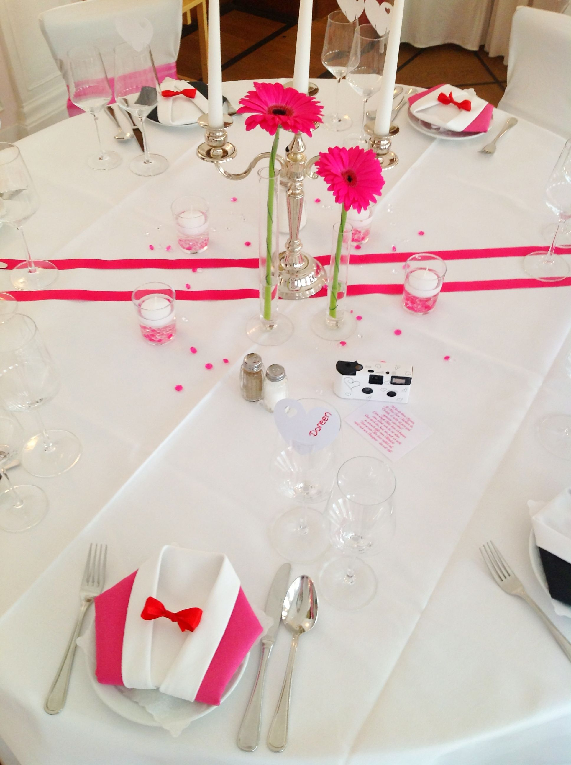 Wedding decoration with pink gerberas and present for the guests mad ...