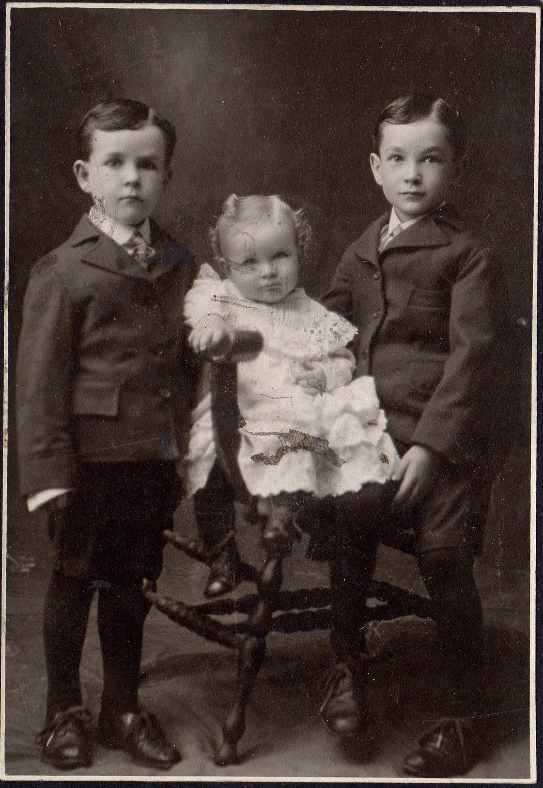 3 unknown kids in pose long ago photo found in colorado