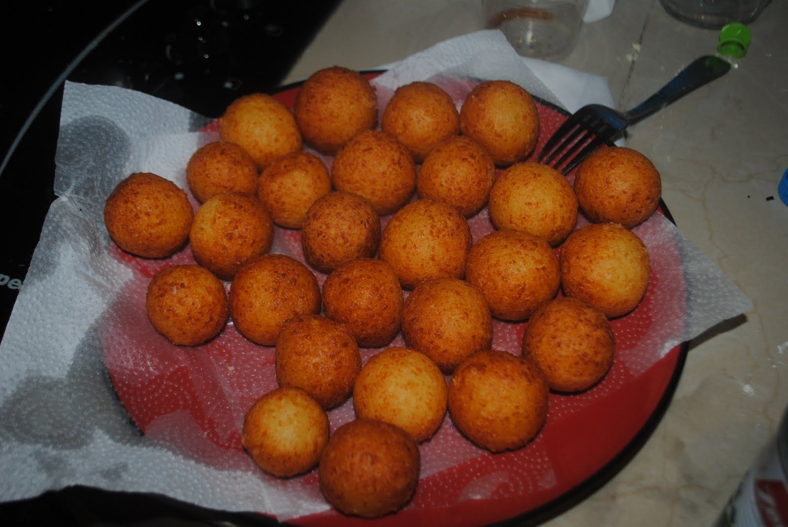 Colombian Buñuelos: a typical dish made of a wheat-based yeast dough. It is mixed with white salted cheese and eaten with Natilla.